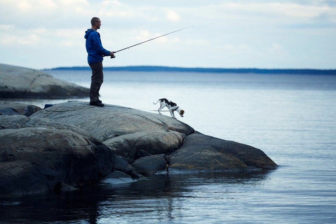 Fishing along with a dog in Sweden