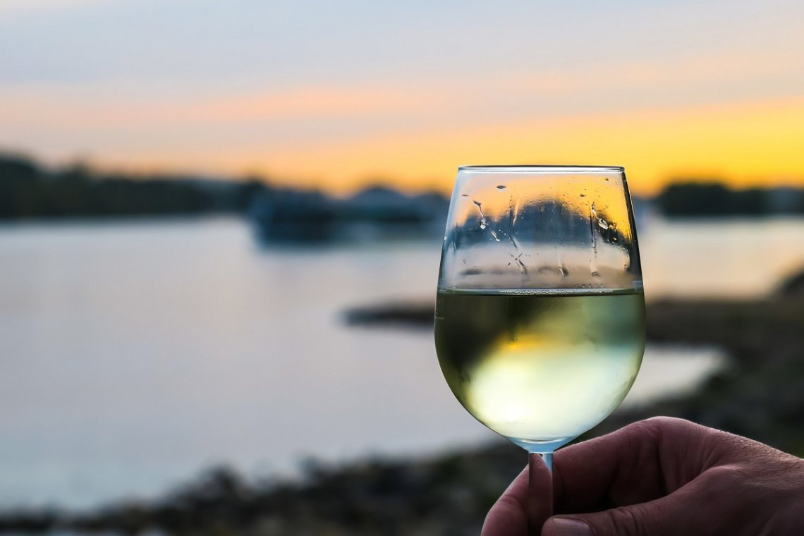 White wine by the sea at sunset